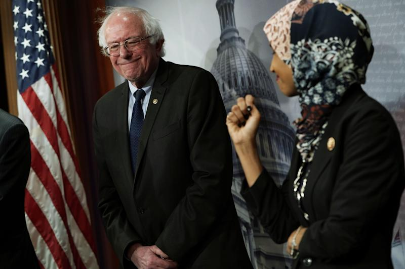 Sen. Bernie Sanders, I-Vt., smiles at Rep. Ilhan Omar, D-Minn., during a news conference on prescription drug pricing in Washington, D.C., in January. (Photo by Alex Wong/Getty Images)