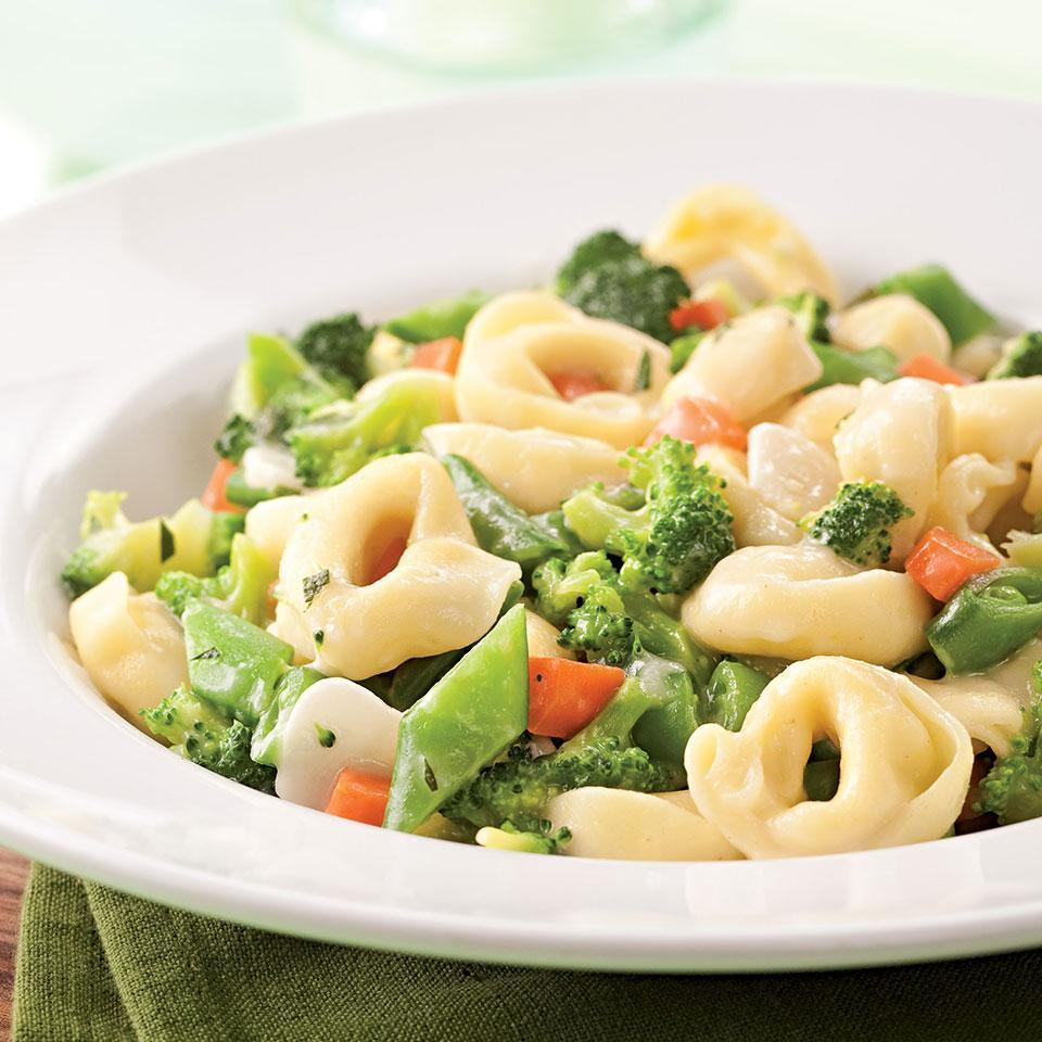 <p>This creamy tortellini and vegetable pasta is a real crowd pleaser. To make it even quicker, use frozen chopped vegetables instead of fresh. Serve with: A green salad and whole-grain baguette.</p>