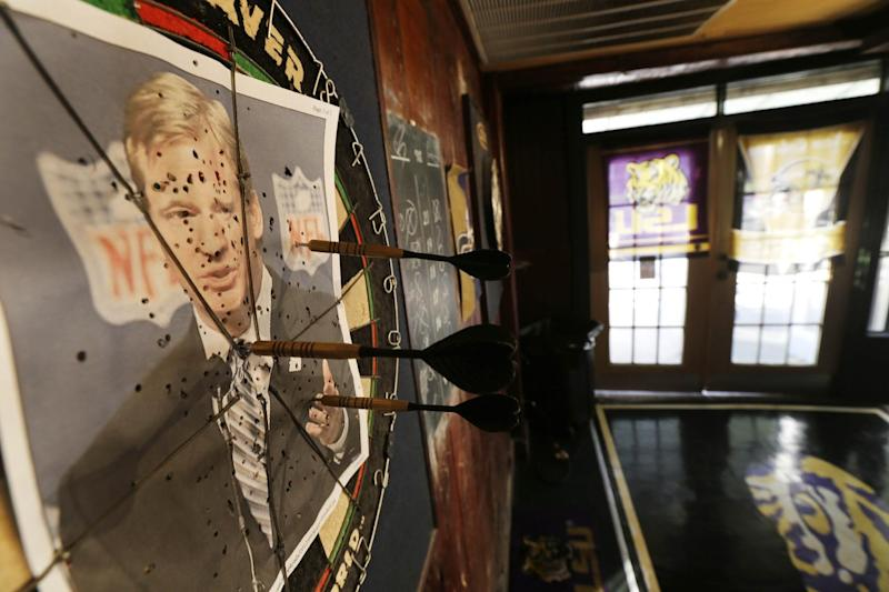 "A photo of NFL commissioner Roger Goodell is seen on a dartboard inside the Parkview Tavern in New Orleans, Friday, Jan. 25, 2013. New Orleans is celebrating the return of New Orleans Saints coach Sean Payton after a season's NFL banishment as a result of the ""Bountygate"" scandal. But the good feeling does not extend to Goodell, who suspended Payton and other key players and coaches last year in the alleged pay-for-pain scheme. He is being ridiculed here with a vehemence usually reserved for the city's multitude of scandal-scarred politicians.(AP Photo/Gerald Herbert)"