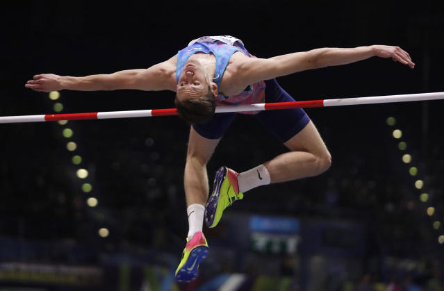 FILE - In this file photo dated Thursday, March 1, 2018, Russia's Danil Lysenko makes an attempt in the men's high jump final at the World Athletics Indoor Championships in Birmingham, England. The president of Russias track and field federation Dmitry Shlyakhtin was suspended Thursday Nov. 21, 2019, on suspicion of obstructing an anti-doping investigation related to Lysenko, who allegedly presented fake medical records. (AP Photo/Matt Dunham, FILE)