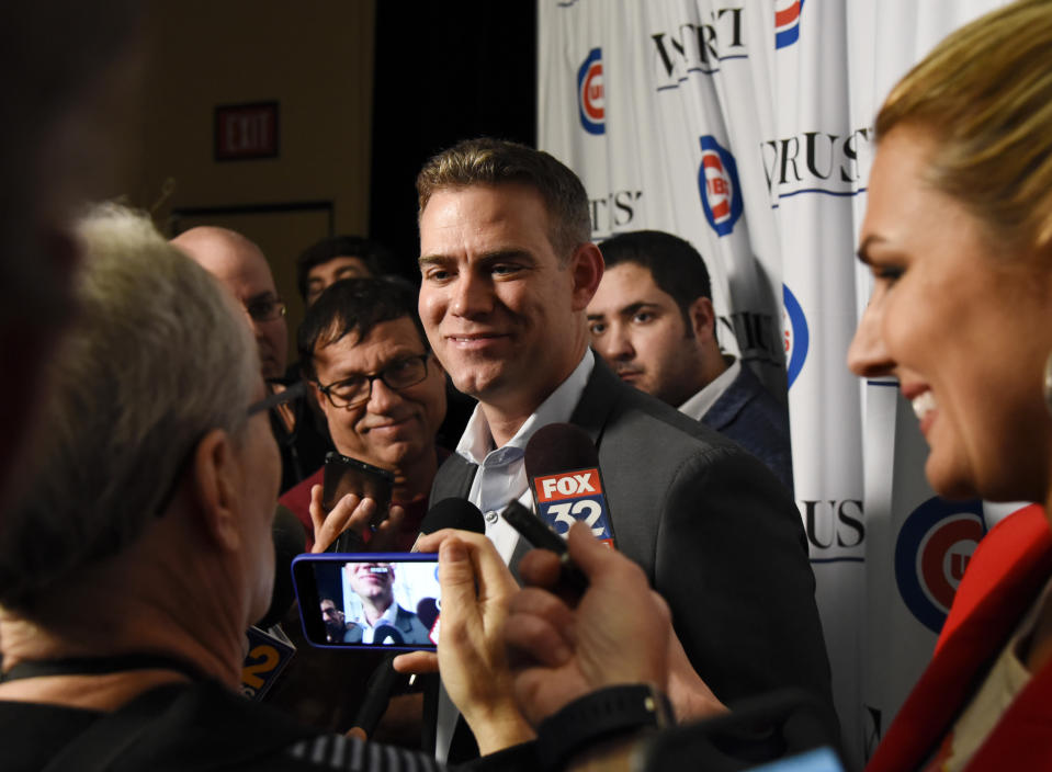 Chicago Cubs' President of Baseball Operations Theo Epstein talks with the media during the team's annual convention Friday, Jan. 18, 2019, in Chicago. (AP Photo/Matt Marton)