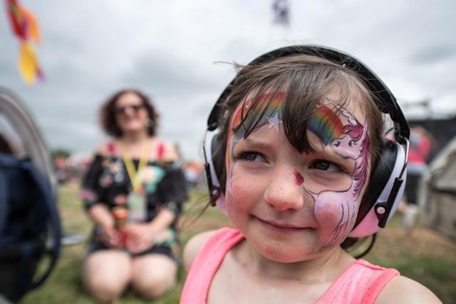 <p>Ellie Woods, 5, watches Charli XCX on The Other Stage with her parents at Glastonbury Festival Site on Worthy Farm in Pilton on June 23, 2017 near Glastonbury, England. (Photo: Chris J Ratcliffe/Getty Images) </p>