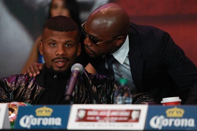Floyd Mayweather (R) speaks to Badou Jack at a New York news conference. Jack may appear on the Aug. 26 Mayweather-Conor McGregor undercard. (Getty Images)