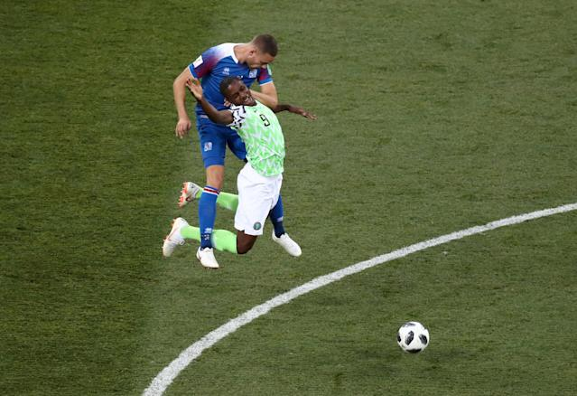 Soccer Football - World Cup - Group D - Nigeria vs Iceland - Volgograd Arena, Volgograd, Russia - June 22, 2018 Nigeria's Odion Ighalo in action with Iceland's Sverrir Ingi Ingason REUTERS/Sergio Perez TPX IMAGES OF THE DAY