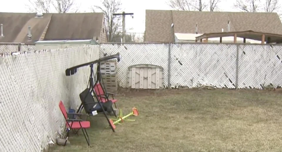The backyard where three-year-old Aziz Ahmed was attacked by his neighbour's dogs.