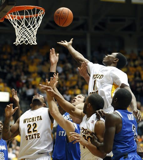 Wichita State's Cleantony Early (11) and Carl Hall (22) battle for a rebound with Indiana State's RJ Mahurin, center, and Manny Arop (3) in the first half during an NCAA college basketball game in Wichita, Kan., Tuesday, Jan. 29, 2013. (AP Photo/The Wichita Eagle, Fernando Salazar)