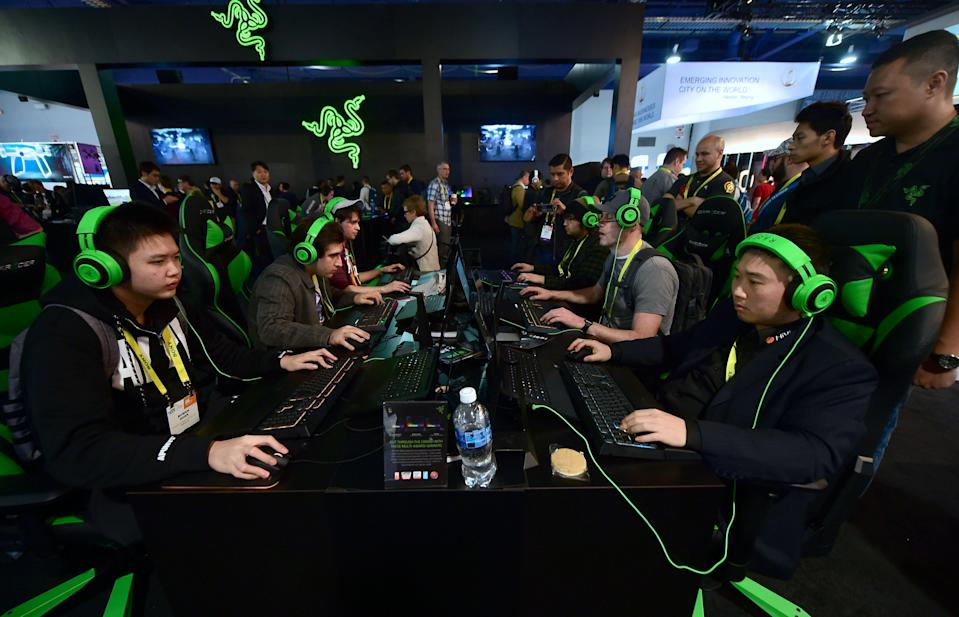Gamers play 'Overwatch' by Blizzard using hardware from Razer during the 2017 Consumer Electronic Show. Photo: Frederic J Brown/AFP via Getty Images