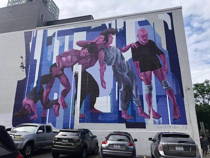 Abstracted Motion by Taylor White at 410 S Salisbury St is one of the first AR murals in the world and was completed in 2018