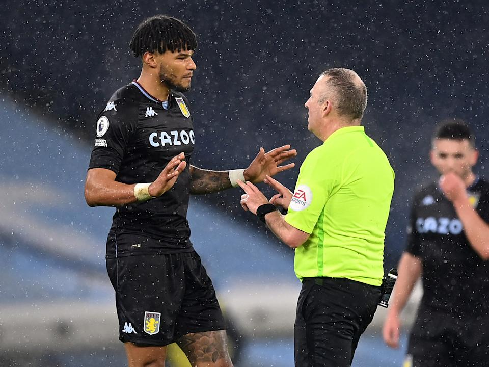 Aston Villa defender Tyrone Mings protests to referee Jonathan Moss (Getty Images)