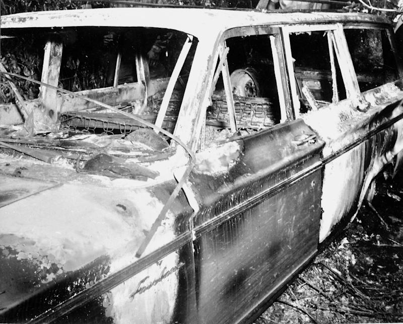 The burned out station wagon that slain civil rights workers James Chaney, Andrew Goodman and Mickey Schwerner were driving in is seen June, 1964 in the Bogue Chitto swamp some 20 kilometers (13 miles) northeast of Philadelphia, Mississippi