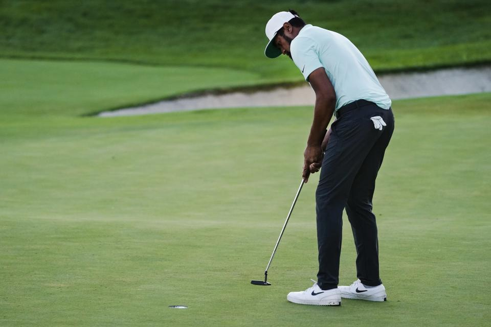 Tony Finau makes the putt on the 18th hole to win during a playoff in the final round at The Northern Trust golf tournament at Liberty National Golf Course Monday, Aug. 23, 2021, in Jersey City, N.J. (AP Photo/John Minchillo)