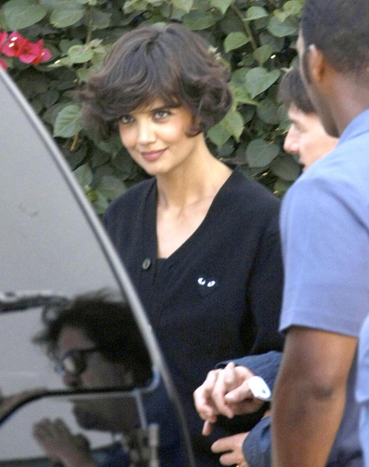 "Katie Holmes debuted a curly coif while shooting scenes for her guest role on ""Eli Stone."" The actress will also show off her singing and dancing skills for one of the ABC drama's musical numbers. IM/<a href=""http://www.x17online.com"" target=""new"">X17 Online</a> - July 15, 2008"