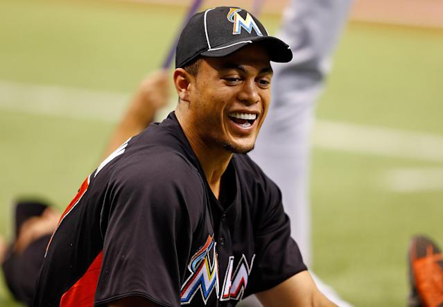 ST PETERSBURG, FL - JUNE 16: Outfielder Giancarlo Stanton #27 of the Miami Marlins stretches just before the start of the game against the Tampa Bay Rays at Tropicana Field on June 16, 2012 in St. Petersburg, Florida. (Photo by J. Meric/Getty Images)