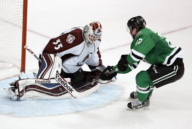 Colorado Avalanche goalie Jean-Sebastien Gigueper, left, is unable to stop a shot by Dallas Stars' Colton Sceviour that clears his leg pads for a score late in the third period of an NHL hockey game, Tuesday, Dec. 17, 2013, in Dallas. The Stars won 3-2. (AP Photo/Tony Gutierrez)