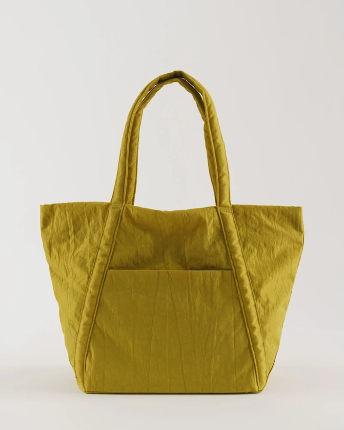 """<strong><h3>BAGGU Travel Cloud Bag</h3></strong><br>This relaxed lightweight tote can easily go from one night to two with its roomy interior and detachable compartment pouches. It's made from durable machine washable heavy-duty nylon and can be easily packed down into almost nothing. <br><br><em>Shop </em><strong><em><a href=""""https://baggu.com"""" rel=""""nofollow noopener"""" target=""""_blank"""" data-ylk=""""slk:Baggu"""" class=""""link rapid-noclick-resp"""">Baggu</a></em></strong><br><br><strong>Baggu</strong> Cloud Bag, $, available at <a href=""""https://go.skimresources.com/?id=30283X879131&url=https%3A%2F%2Fbaggu.com%2Fcollections%2Ftotes%2Fproducts%2Fcloud-bag-lentil"""" rel=""""nofollow noopener"""" target=""""_blank"""" data-ylk=""""slk:Baggu"""" class=""""link rapid-noclick-resp"""">Baggu</a>"""