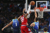 Dallas Mavericks guard Courtney Lee (1) and forward Dwight Powell (7) try to defend against a shot by Sacramento Kings forward Richaun Holmes (22) in the first half of an NBA basketball game Sunday, Dec. 8, 2019, in Dallas. (AP Photo/Richard W. Rodriguez)