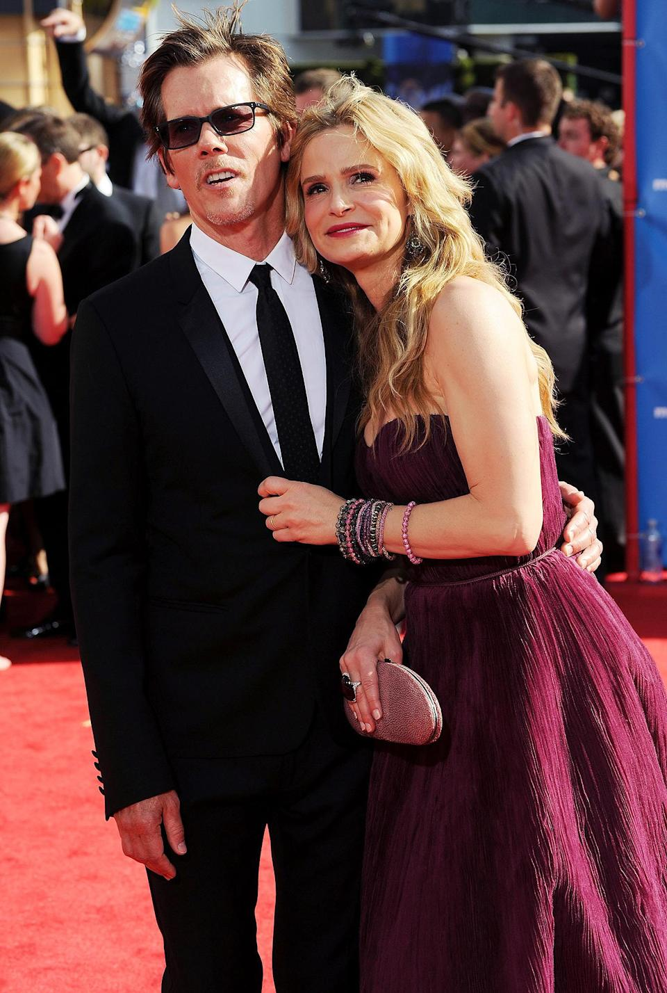 <p>Kevin Bacon and Kyra Sedgwick cuddled up on the carpet ahead of Sedgwick taking home the Emmy for lead actress in a drama series for her work on <em>The Closer</em>. </p>