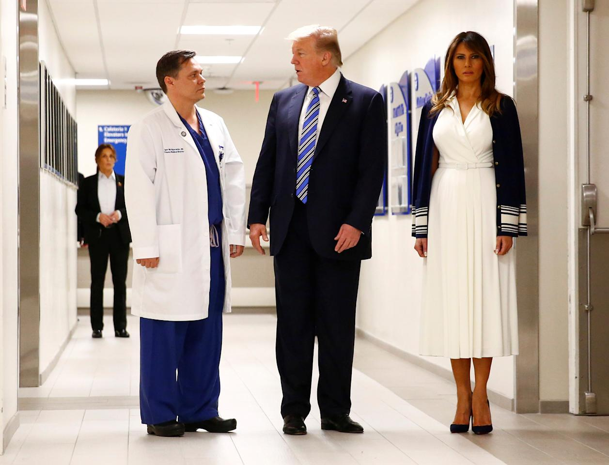 U.S. President Donald Trump and first lady Melania Trump visit with Dr. Igor Nichiporenko, trauma surgeon at Broward Health North Hospital in the wake of the shooting at Marjory Stoneman Douglas High School in Pompano Beach, Florida, U.S., February 16, 2018. REUTERS/Eric Thayer