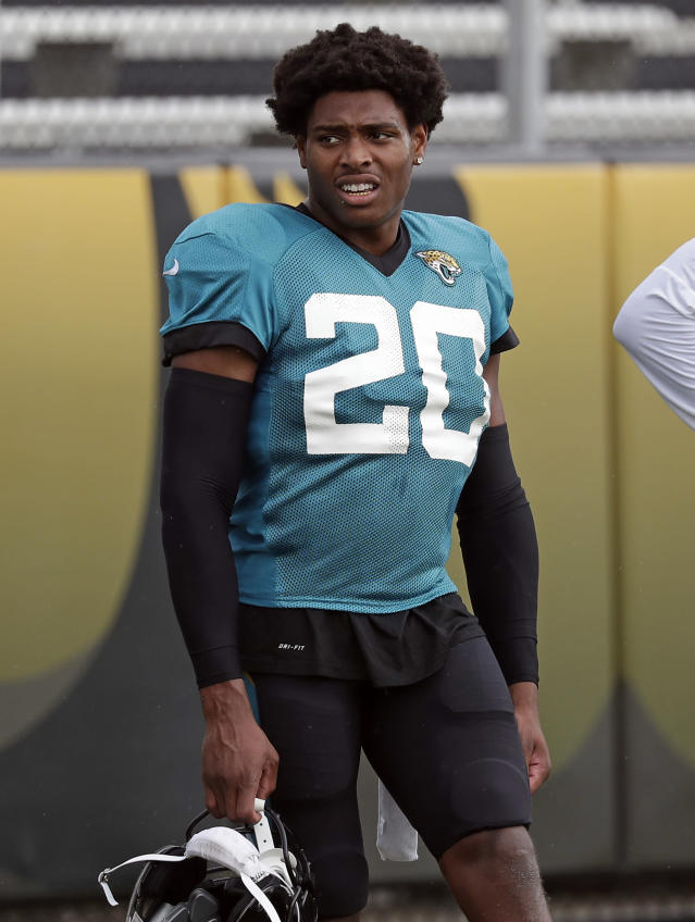In this July 31, 2018 photo Jacksonville Jaguars cornerback Jalen Ramsey (20) takes a break during a practice at NFL football training camp in Jacksonville, Fla. Ramsey and defensive end Dante Fowler are back from suspension. They were not available during an open locker room session Monday, Aug. 20, 2018. The team says both players will answer questions following Jacksonville's preseason game against the Atlanta Falcons on Saturday night. (AP Photo/John Raoux)