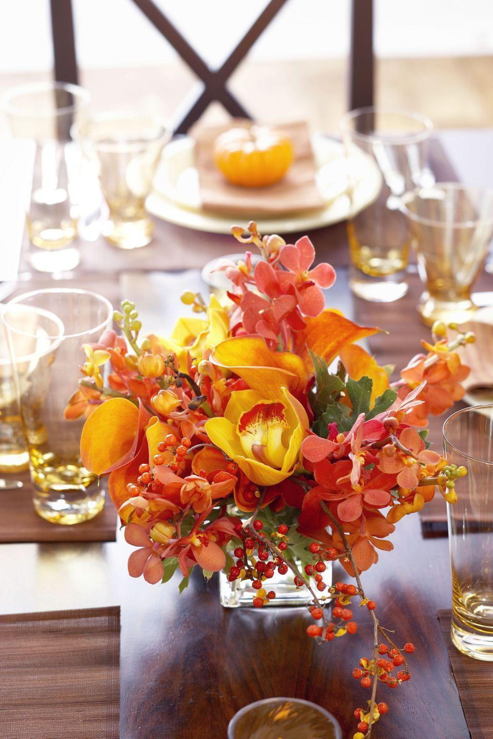 <p>When it doubt, choose a bold arrangement of flowers in autumnal hues. Incorporate berry branches to make even more of a statement.</p>