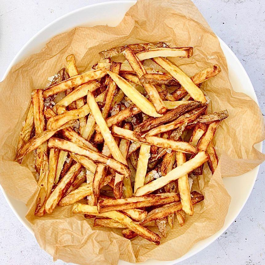 """<p>If you're looking for a new way of making homemade chips, we think <a href=""""https://www.delish.com/uk/food-news/g34342565/best-air-fryer-deals-amazon-prime-day/"""" rel=""""nofollow noopener"""" target=""""_blank"""" data-ylk=""""slk:air fryer"""" class=""""link rapid-noclick-resp"""">air fryer</a> chips are the way to go. Not only is cooking chips in your air fryer a convenient way of making them, you're also sure to get super-crispy chips without having to cook them in tons of oil. This also makes them a healthier option. Win-win!</p><p>Get the <a href=""""https://www.delish.com/uk/cooking/recipes/a36738187/air-fryer-chips/"""" rel=""""nofollow noopener"""" target=""""_blank"""" data-ylk=""""slk:Air Fryer Chips"""" class=""""link rapid-noclick-resp"""">Air Fryer Chips</a> recipe.</p>"""