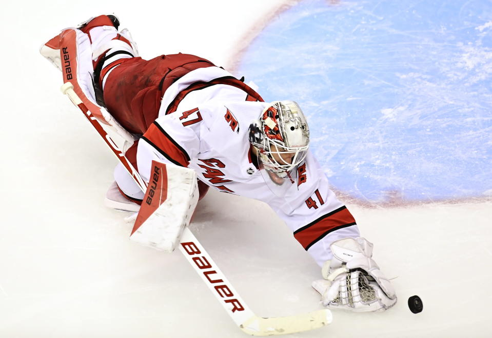 Carolina Hurricanes' goaltender James Reimer (47) reaches for a puck against the New York Rangers during second period NHL Eastern Conference Stanley Cup playoff action in Toronto on Tuesday, Aug. 4, 2020. (Frank Gunn/The Canadian Press via AP)