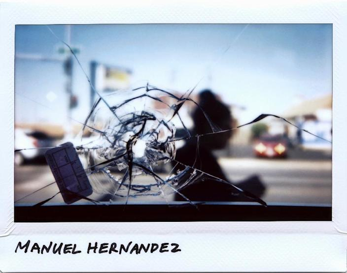 A bullet hole in a restaurant window, linked to the fatal shooting of 30-year-old Manuel Hernandez, in Chicago, Illinois in September, 2017 (AFP Photo/JIM YOUNG)