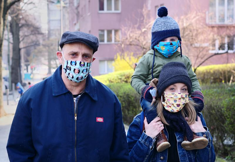 28 March 2022, Berlin: A family goes for a walk in Friedenau. All family members wear colorful masks as protection against the coronavirus. The masks were sewn by a friend of the family herself. Photo: Wolfram Steinberg/dpa (Photo by Wolfram Steinberg/picture alliance via Getty Images)