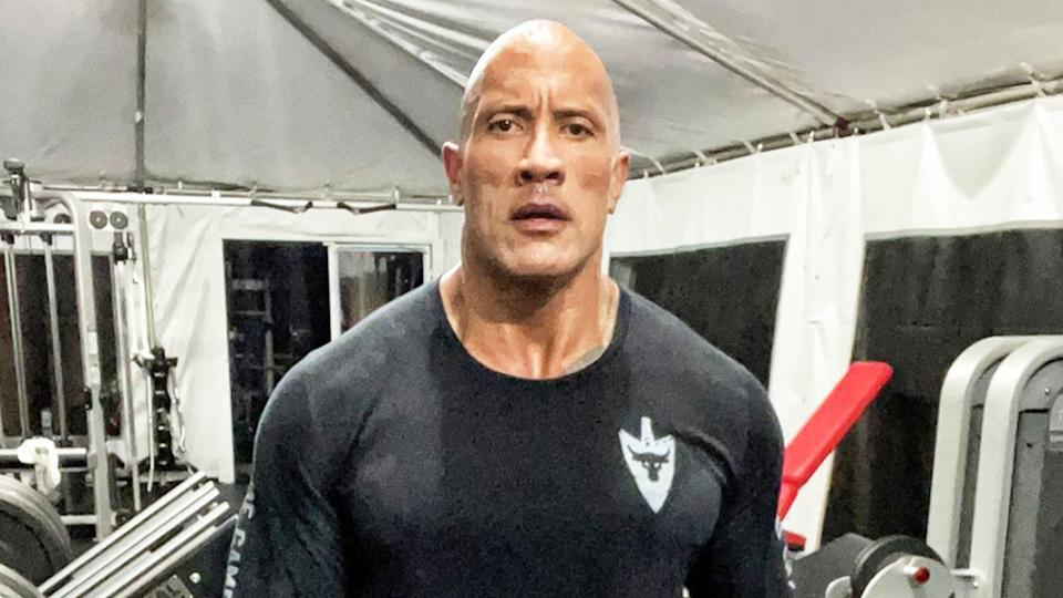 Dwayne, The Rock, Johnson (pictured) posing for a photo after working out.