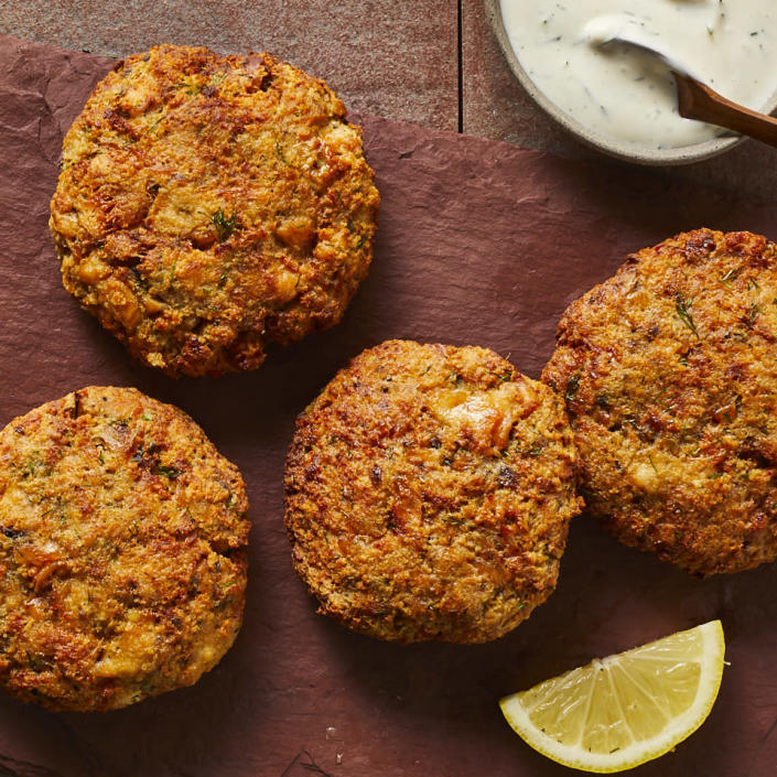 """<p>These air-fried salmon patties are reminiscent of classic salmon croquettes, crispy on the outside and pillowy tender on the inside. Look for canned or jarred salmon that has less than 50 milligrams of sodium per serving, and don't be afraid of varieties that have bones. They're easy to remove. <a href=""""http://www.eatingwell.com/recipe/270219/air-fryer-salmon-cakes/"""" rel=""""nofollow noopener"""" target=""""_blank"""" data-ylk=""""slk:View recipe"""" class=""""link rapid-noclick-resp""""> View recipe </a></p>"""