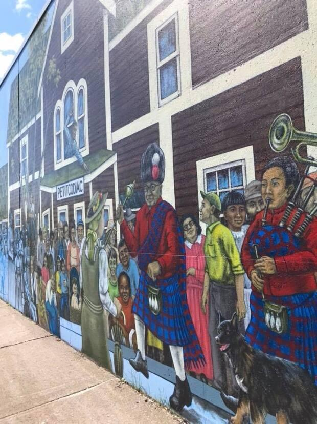 """Mural Doctor"" Fred Harrison painted this historical mural in Petitcodiac in 2018 as part of Festival Inspire."
