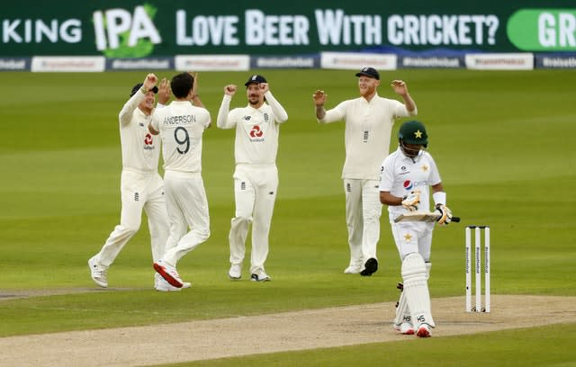 Anderson celebrates taking the wicket of Pakistan's Babar Azam