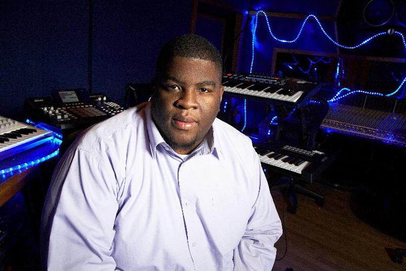 """This Jan. 29, 2013 photo shows Grammy-nominated producer Salaam Remi posing for a portrait at his studio in New York. Remi, best known for his work with Amy Winehouse and Nas, is nominated for non-classical producer of the year at Sunday's Grammy Awards. Last year, his production credits include songs on Nas' """"Life Is Good"""" and Miguel's """"Kaleidoscope Dream,"""" as well as Alicia Keys' R&B hit """"Girl on Fire."""" (Photo by Dan Hallman/Invision/AP)"""