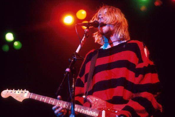 <p>Kurt Cobain performs on stage in 1993. His oversized baggy sweater was a staple of the grunge look popular in the early '90s.</p>