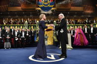 "FILE - In this Dec. 10, 2018, file photo, Chemistry laureate Frances H. Arnold, left, receives the prize from King Carl Gustaf of Sweden, during the Nobel Prize award ceremony, at the Stockholm Concert Hall, in Stockholm. The Nobels, with new winners announced starting Monday, Oct. 5, 2020, often concentrate on unheralded, methodical, basic science. ""Without basic science, you won't have cutting-edge applied science,"" said Frances Arnold, a Caltech chemical engineer who won the 2018 Nobel in chemistry. (Pontus Lundahl/Pool Photo via AP, File)"