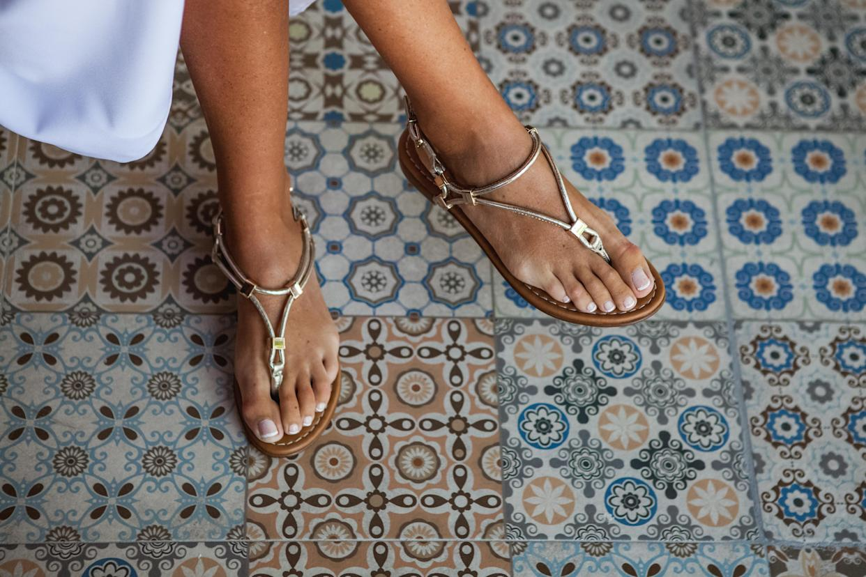 Take care of your feet and bring those sandals out of hiding. (Photo: Getty)