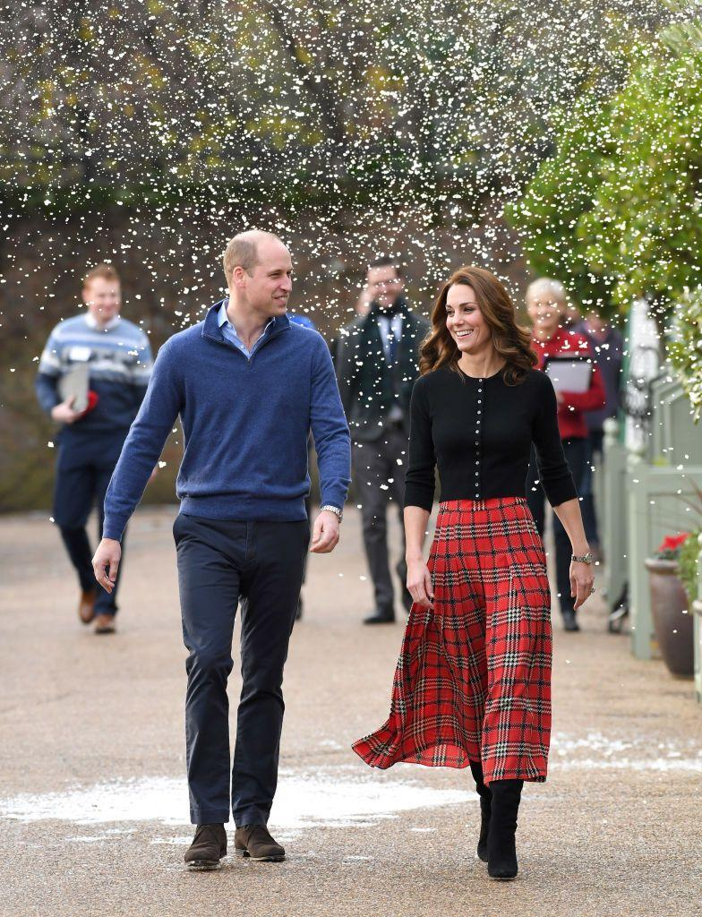 <p>Kate Middleton and Prince William hosted a very Christmassy event at Kensington Palace for children of military families—fake snow and all.</p>