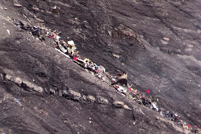 A screen grab taken on March 24, 2015 shows debris of the Germanwings Airbus A320 crash site in the French Alps, above the southeastern town of Seyne