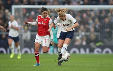 Rachel Furness of Tottenham battles with Danielle van de Donk  - Credit: Getty images