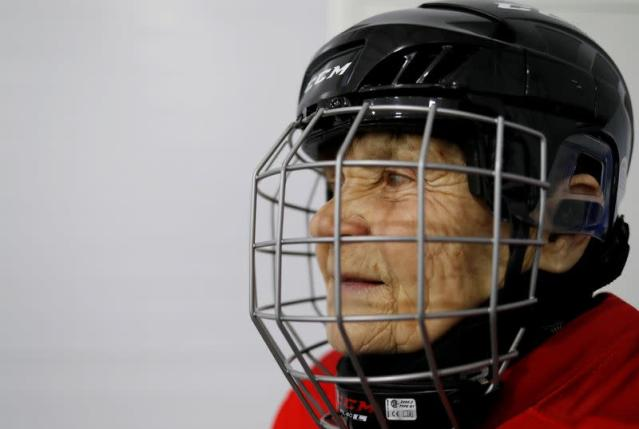 Valentina Fyodorova, 80, the captain of a senior women's hockey team, looks on before a match in Bereznik