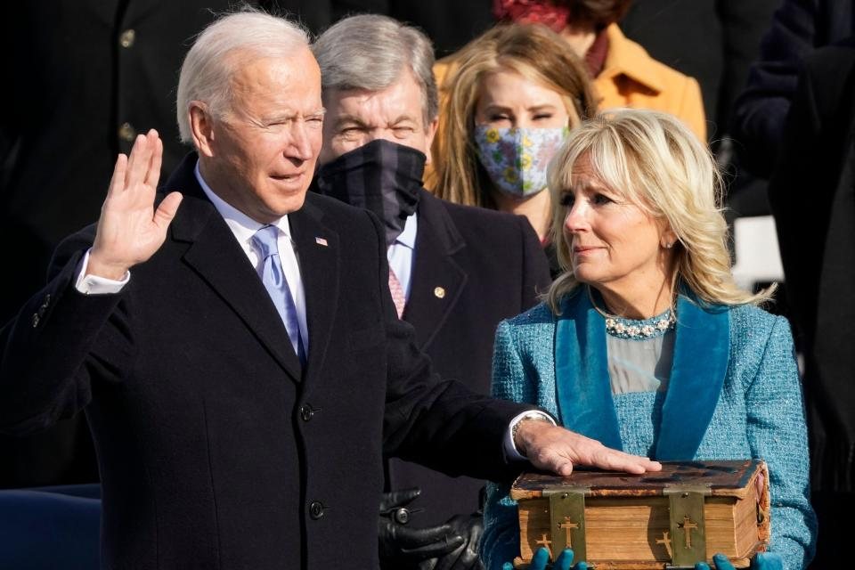 <strong>Joe Biden is sworn in as the 46th president of the United States by Chief Justice John Roberts as Jill Biden holds the Bible.</strong> (Photo: ASSOCIATED PRESS)