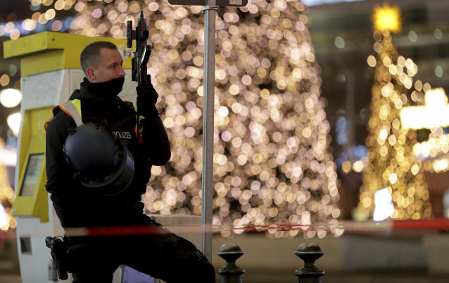 A police officer secures the evacuated Christmas market at the Breitscheidplatz in Berlin, Germany, Saturday, Dec. 21, 2019 after a suspicious object was found at the Christmas market. (AP Photo/Michael Sohn)