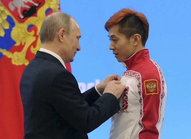 FILE PHOTO: Russian President Vladimir Putin (L) awards Russian short track speed skater Viktor Ahn during a ceremony in Sochi, Russia February 24, 2014. Mikhail Klimentyev/RIA Novosti/Kremlin/File Photo via REUTERS ATTENTION EDITORS - THIS IMAGE WAS PROVIDED BY A THIRD PARTY.