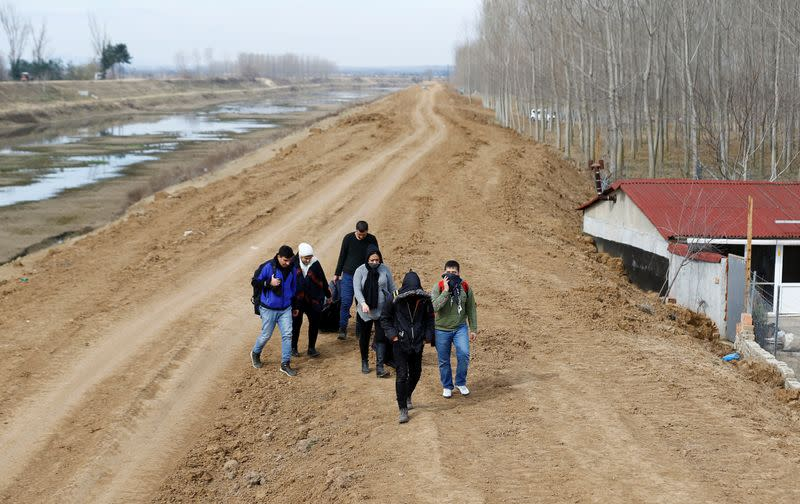 A group of migrants walk through the Turkish-Greek border in a village Bosnakoy near the border city of Edirne
