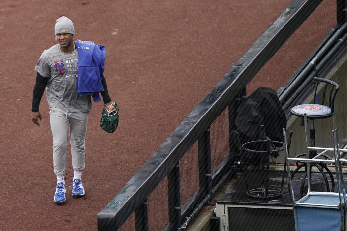 New York Mets pitcher Marcus Stroman leaves the field after working out before a baseball game against the Atlanta Braves was postponed due to rain, Sunday, May 30, 2021, in New York. (AP Photo/Kathy Willens)