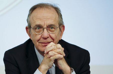 Padoan listens to a reporter's question during a news conference in Rome