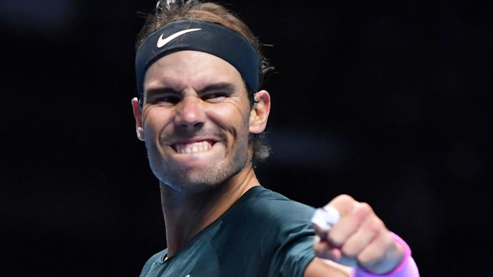 Pictured here, Rafael Nadal celebrates after sealing a spot in the last four at the ATP Finals.