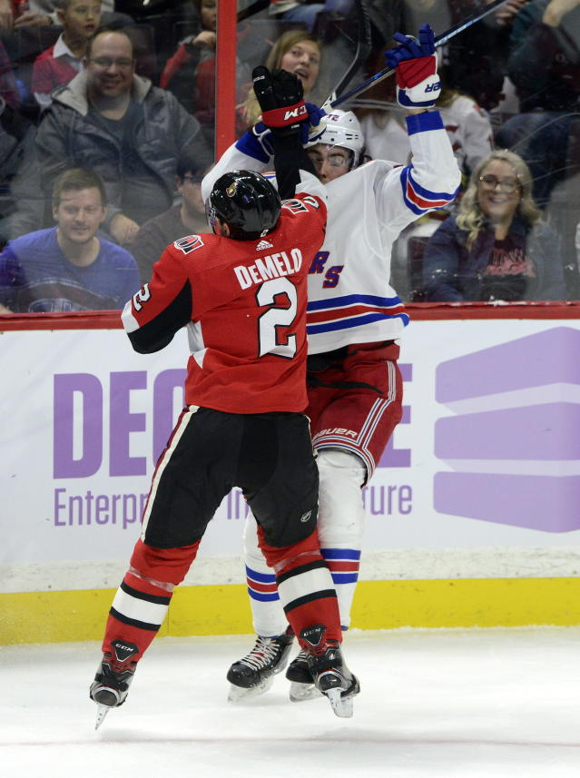 Ottawa Senators defenseman Dylan DeMelo (2) hits New York Rangers centre Filip Chytil (72) during the first period of an NHL hockey game Friday, Nov. 22, 2019, in Ottawa, Ontario. (Sean Kilpatrick/The Canadian Press via AP)
