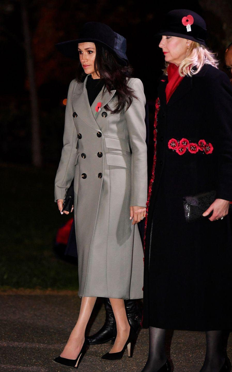 """<p>Meghan attended an <a href=""""https://www.townandcountrymag.com/society/tradition/a20060050/prince-william-anzac-day-royal-baby-3-comments/"""" rel=""""nofollow noopener"""" target=""""_blank"""" data-ylk=""""slk:early morning memorial service in honor of Anzac Day"""" class=""""link rapid-noclick-resp"""">early morning memorial service in honor of Anzac Day</a> wearing a coat by Smythe with Sarah Flint pumps and a Gucci mini bag. </p><p><a class=""""link rapid-noclick-resp"""" href=""""https://go.redirectingat.com?id=74968X1596630&url=https%3A%2F%2Fwww.sarahflint.com%2Fproducts%2Fjay-pump-100-black-suede%3Fvariant%3D28249886273&sref=https%3A%2F%2Fwww.townandcountrymag.com%2Fstyle%2Ffashion-trends%2Fg3272%2Fmeghan-markle-preppy-style%2F"""" rel=""""nofollow noopener"""" target=""""_blank"""" data-ylk=""""slk:SHOP NOW"""">SHOP NOW</a> <em>Sarah Flint Jay Pump, $395</em><br></p><p><a class=""""link rapid-noclick-resp"""" href=""""https://go.redirectingat.com?id=74968X1596630&url=https%3A%2F%2Fwww.saksfifthavenue.com%2Fmain%2FProductDetail.jsp%3FPRODUCT%253C%253Eprd_id%3D845524447112556&sref=https%3A%2F%2Fwww.townandcountrymag.com%2Fstyle%2Ffashion-trends%2Fg3272%2Fmeghan-markle-preppy-style%2F"""" rel=""""nofollow noopener"""" target=""""_blank"""" data-ylk=""""slk:SHOP NOW"""">SHOP NOW</a> <em>Gucci Dionysus Mini Shoulder Bag, $830</em></p>"""