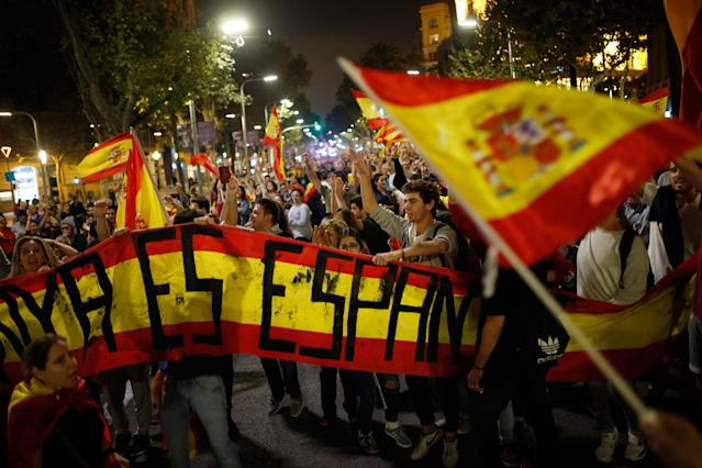 <p>Anti-independence supporters shout slogans and wave Spanish flags as they march against the unilateral declaration of independence approved earlier by the Catalan parliament in downtown Barcelona Friday, Oct. 27, 2017. (Photo: Francisco Seco/AP) </p>
